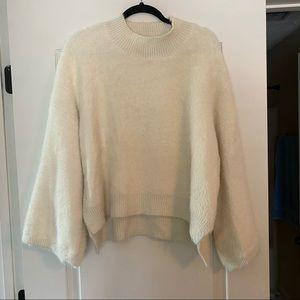 Soft white fuzzy sweater